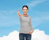 Smiling girl in casual clother showing thumbs up Royalty Free Stock Images