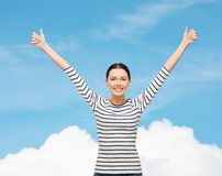 Smiling girl in casual clother showing thumbs up Royalty Free Stock Image
