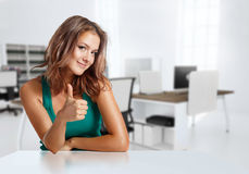 Smiling girl in casual clothes in the office Stock Images