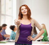 Smiling girl in casual clothes showing thumbs up Royalty Free Stock Images