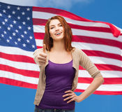 Smiling girl in casual clothes showing thumbs up Royalty Free Stock Photography