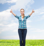 Smiling girl in casual clothes showing thumbs up Royalty Free Stock Photos