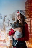 Smiling girl with a cat in hands. Vertical photo. Stock Image