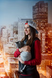 Smiling girl with a cat in hands Stock Images