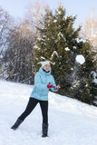 Smiling girl catching snowball Royalty Free Stock Photo