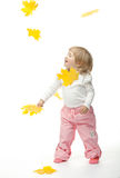 The smiling girl catching yellow leaves Royalty Free Stock Photo