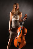 Smiling girl with cello. Studio isolated shot Stock Photography