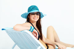 Smiling girl chaise lounge Stock Images