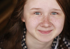 Smiling girl with charming freckled face Royalty Free Stock Photo