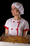 Smiling girl chef with pizza in hands Stock Image