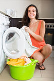 Smiling girl cheking white clothes Stock Photos