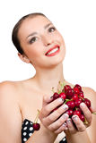 Smiling girl with cherries Royalty Free Stock Images