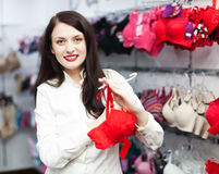 Smiling girl choosing bra Royalty Free Stock Images