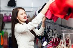 Smiling girl choosing bra at fashion store Stock Photography