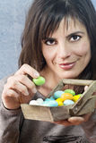 Smiling girl choosing green easter egg Stock Image