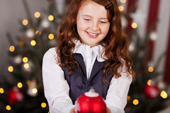 Smiling girl with a Christmas ball Stock Image
