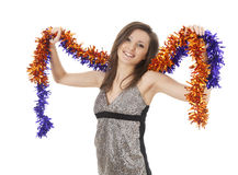 Smiling girl with christmas decoration chain Royalty Free Stock Images