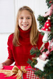 Smiling girl with christmas gift Royalty Free Stock Images