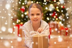 Smiling girl with christmas gift at home royalty free stock image
