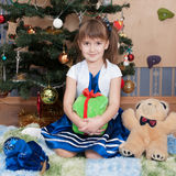 Smiling girl with Christmas gifts at Christmas tree (6 years) Royalty Free Stock Image