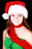 Smiling girl in christmas hat over dark Royalty Free Stock Photo