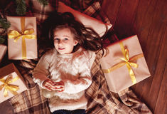 Smiling girl with christmas presents Royalty Free Stock Images