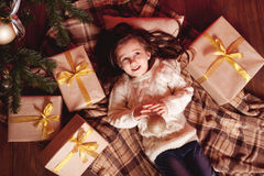 Smiling girl with christmas presents Stock Image