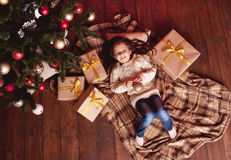 Smiling girl with christmas presents Royalty Free Stock Photo
