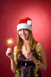 Smiling girl with Christmas sparkler stock photo