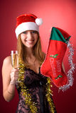 Smiling girl with Christmas stocking Royalty Free Stock Images