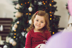 Smiling Girl at Christmas Tree Stock Photos