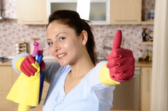 Smiling girl cleaning the house royalty free stock image