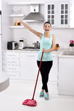 Smiling girl cleaning the house Royalty Free Stock Photography
