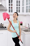 Smiling girl cleaning the house Stock Photo