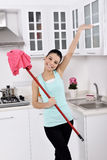 Smiling girl cleaning the house Royalty Free Stock Images