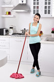 Smiling girl cleaning the house Royalty Free Stock Photo