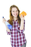 Smiling girl with cleaning supplies Royalty Free Stock Photos