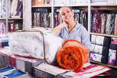 Smiling girl client shopping new blanket and coverlet Stock Images