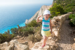 Smiling girl on a cliff Stock Photography
