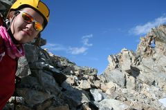 Smiling girl climber. With sunglasses Royalty Free Stock Photos