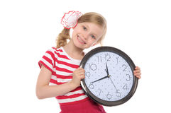 Smiling girl with clock Royalty Free Stock Images