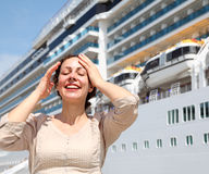 Smiling girl with closed eyes stands near the ship Royalty Free Stock Photography