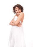 A smiling girl, clothed a white sheet Stock Photography