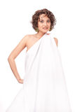 A smiling girl, clothed a white sheet Royalty Free Stock Images