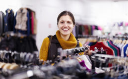Smiling girl  at clothing store Royalty Free Stock Images