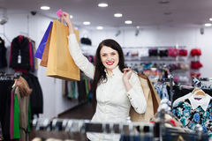 Smiling girl at clothing store Royalty Free Stock Photography