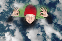 Smiling girl in the clouds Stock Image