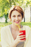 Smiling girl and a cocktail Stock Photos