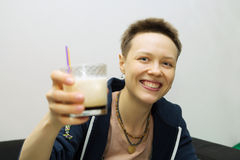 Smiling girl with a cocktail. White Russian isolated Royalty Free Stock Photography