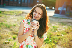 Smiling girl with coffee Royalty Free Stock Photo